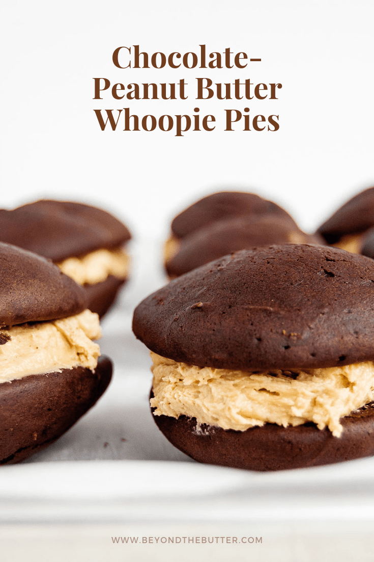 Chocolate-Peanut Butter Whoopie Pies | Close up photo of chocolate-peanut butter whoopie pies on a tray with parchment paper | Image and Copyright Policy: © Beyond the Butter, LLC