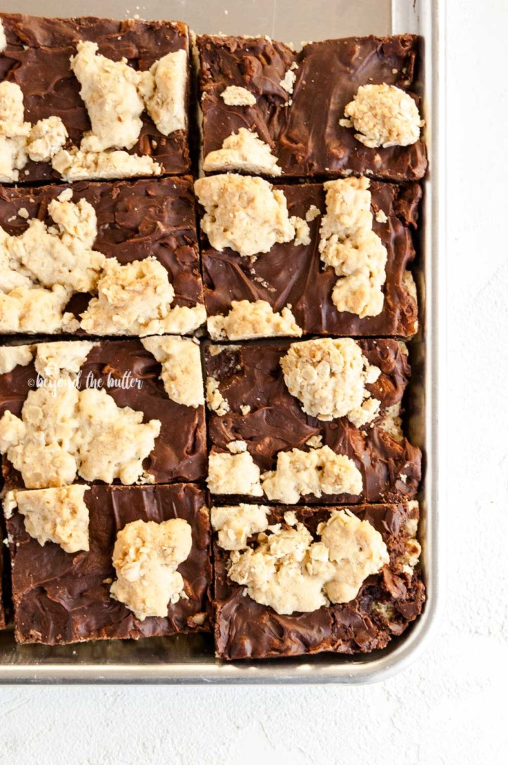 Overhead image of cut fudge nut bars on a baking tray   All Images © Beyond the Butter™