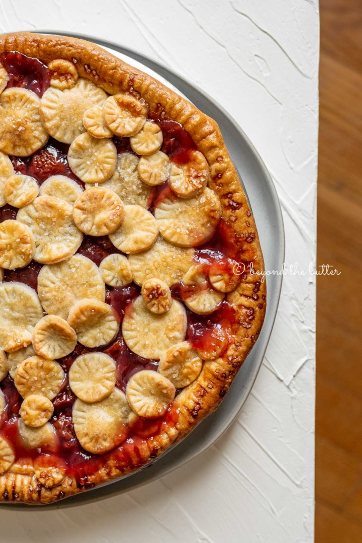 Image of cherry pie placed close to the edge of the table | All Images © Beyond the Butter™