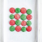 Almond Sprinkle Cookies | overhead shot of red and green almond sprinkle cookies in an alternating patter | Image Credit: Beyond the Butter, LLC