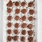 Homemade Peppermint Patties | Overhead shot of Homemade Peppermint Patties drizzled in chocolate and dusted lightly with cocoa | Image Credit and Copyright: Beyond the Butter, LLC