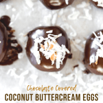 Chocolate Covered Coconut Buttercream Eggs | Close up photo of chocolate covered coconut buttercream eggs topped with toasted coconut on a baking sheet | Image and Copyright Policy: © Beyond the Butter, LLC