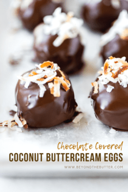 Chocolate Covered Coconut Buttercream Eggs   Close up photo of chocolate covered coconut buttercream eggs topped with toasted coconut on a baking sheet   Image and Copyright Policy: © Beyond the Butter, LLC