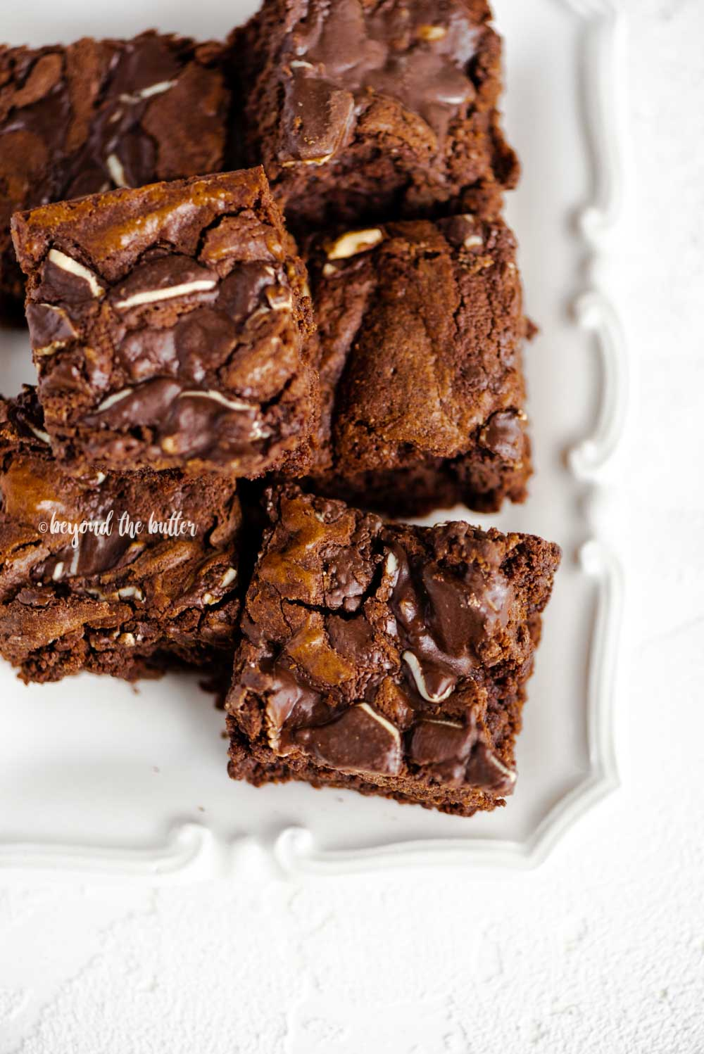 Double Chocolate Mint Brownies | Overhead close up photo of double chocolate mint brownies on a white decorative plate | Image and Copyright Policy: © Beyond the Butter, LLC