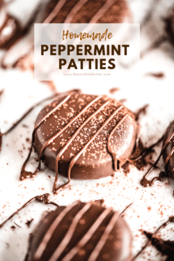 Homemade Peppermint Patties | Angled and up close shot of Homemade Peppermint Patties drizzled in chocolate and dusted lightly with cocoa | Image Credit and Copyright: Beyond the Butter, LLC