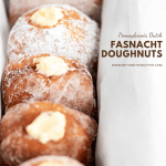 Pennsylvania Dutch Fasnacht Doughnuts | Angled photo of 5 vanilla creme filled Pennsylvania Dutch Fasnacht Doughnuts in a metal loaf pan wrapped with parchment paper | Image and Copyright Policy: © Beyond the Butter, LLC