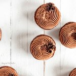 Fudgy Brownie Bites with Chocolate Mascarpone Whipped Cream | Overhead photo of brownie bites decorated with chocolate mascarpone whipped cream and chocolate curls | Image and Copyright Policy: © Beyond the Butter, LLC