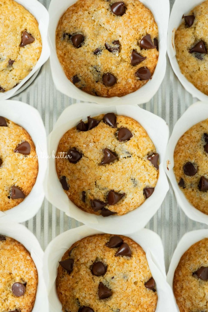 Muffin tin with bakery style chocolate chip muffins in tulip style liners   © Beyond the Butter®