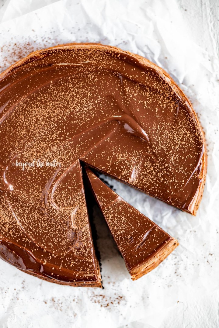 Triple Chocolate Mocha Cheesecake with a slice removed | All Images © Beyond the Butter, LLC