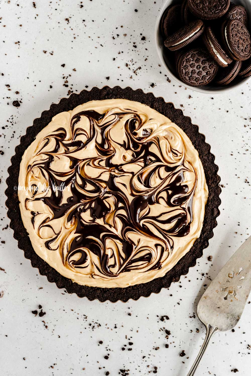 Overhead image of chocolate peanut butter swirl tart | All Images © Beyond the Butter™