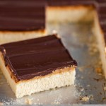 Closeup angled image of cut irresistible peanut butter tandy kakes with one angled out from the rest | All Images © Beyond the Butter™