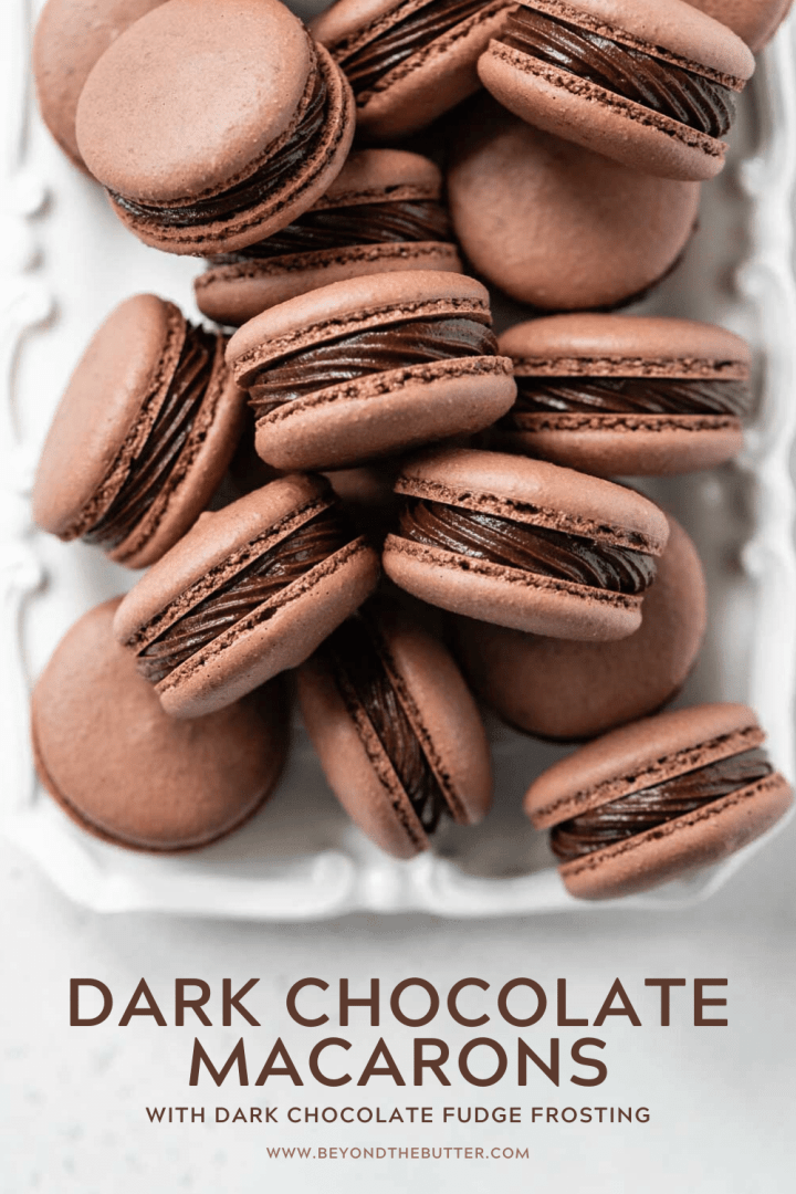 Pinterest image of dark chocolate macarons with dark chocolate fudge frosting | All Images © Beyond the Butter™