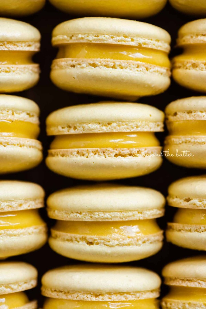 Close up of lemon bar macarons on side | All Images © Beyond the Butter™
