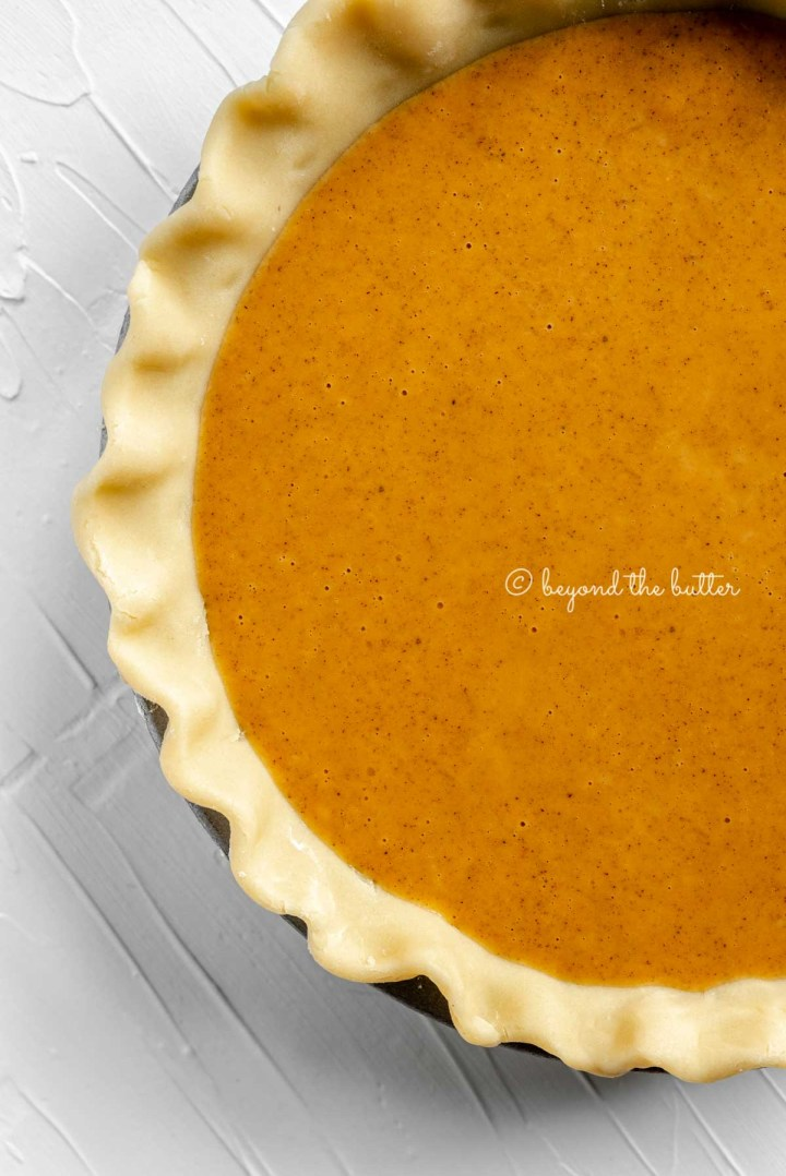 Unbaked pumpkin pie ready for the oven | All Images © Beyond the Butter™