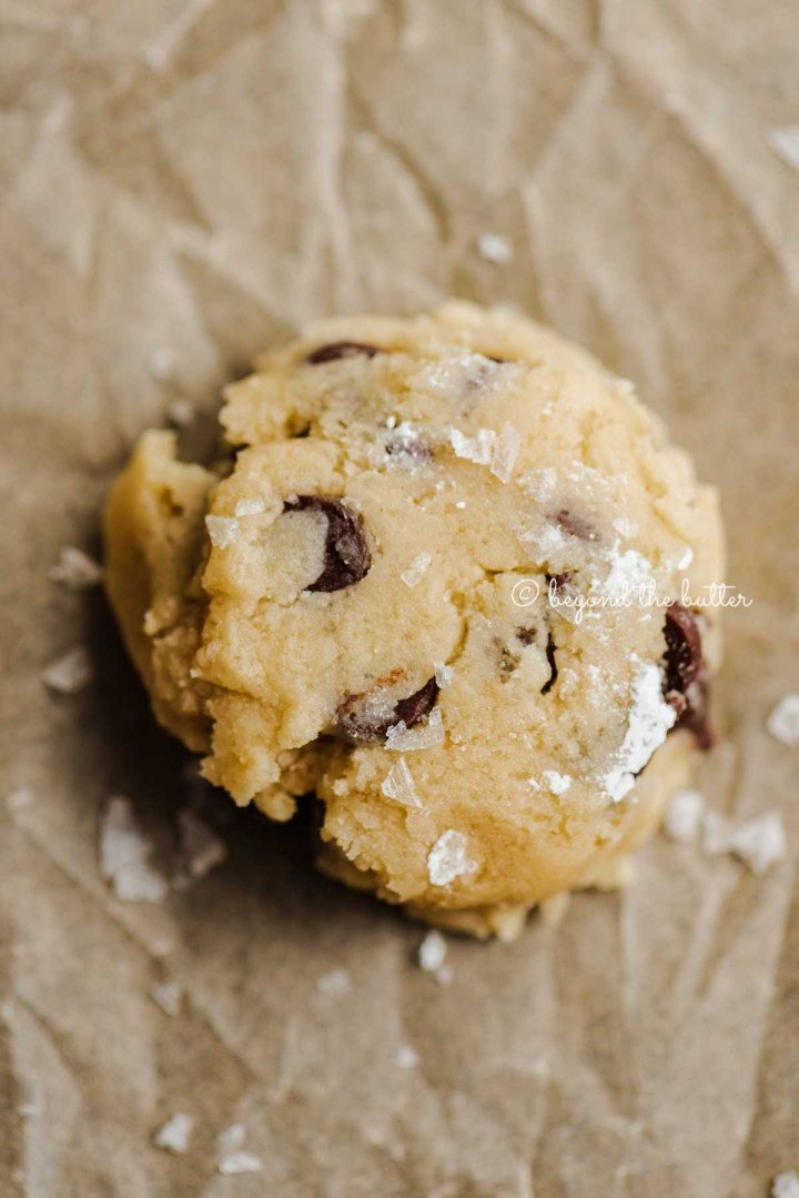 Flattened chocolate chip cookie ready for baking | All Images © Beyond the Butter®