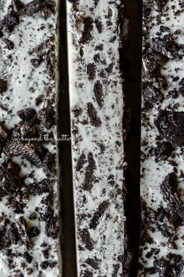 Bars of cookies and cream fudge on brown parchment paper | All Images © Beyond the Butter®
