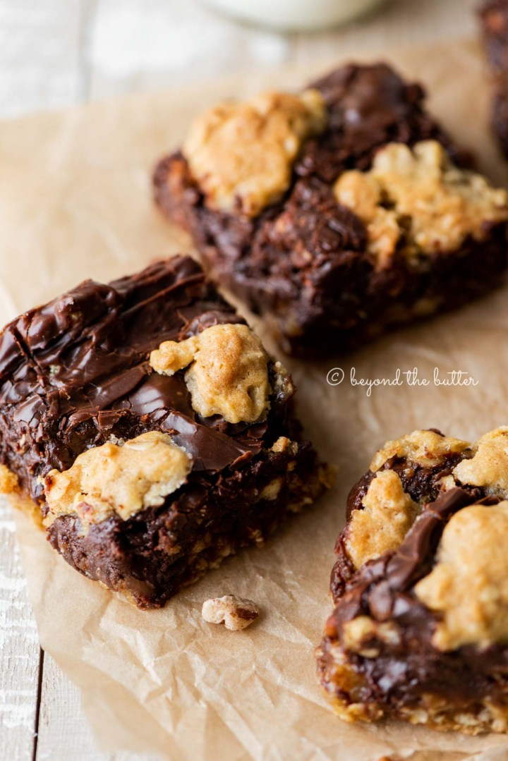 Classic oatmeal fudge bars on parchment paper | All Images © Beyond the Butter®