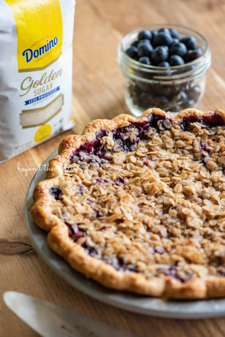 Just baked blueberry crumble pie made with Domino® Golden Sugar   © Beyond the Butter®