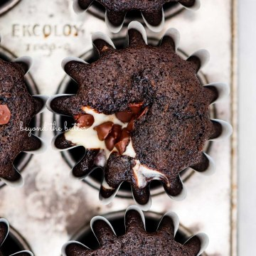 Vintage baking tin filled with small batch black bottom cucpakes from BeyondtheButter.com | © Beyond the Butter®
