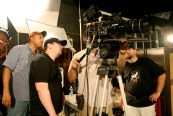 DoP Mike Lynch, Dir. Shawn Montgomery and 1st AD Van Hayden frame a shot.