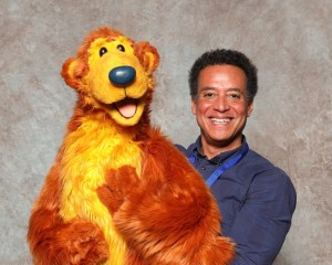Noel MacNeal Poses with the Bear in the Big Blue House puppet