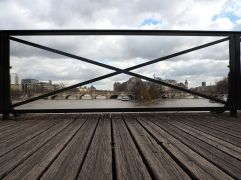 A framed view of the Seine from the Pont des Arts