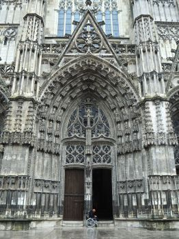 The central west door of the cathedral, dwarfed by its intricately carved surround