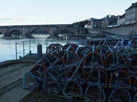 Lobster pots on the quay by Berwick Bridge