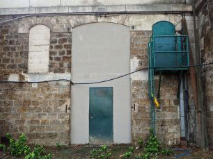 The quays of the Seine were once lined with warehouses built into the walls; now they are lined with bricked up doorways and mysterious doors.