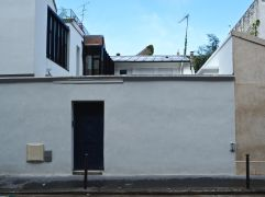 The wide windows of an artist's studio and the hint of a hidden courtyard, glimpsed over the wall of number 10