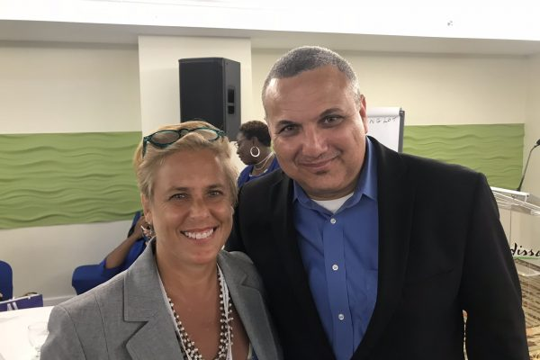 Ashli Komaryk with fellow conference presenter, Franz Manderson, Deputy Governor and Head of the Civil Service, Cayman Islands Government