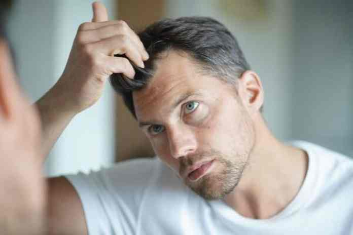 a man worried about hair loss
