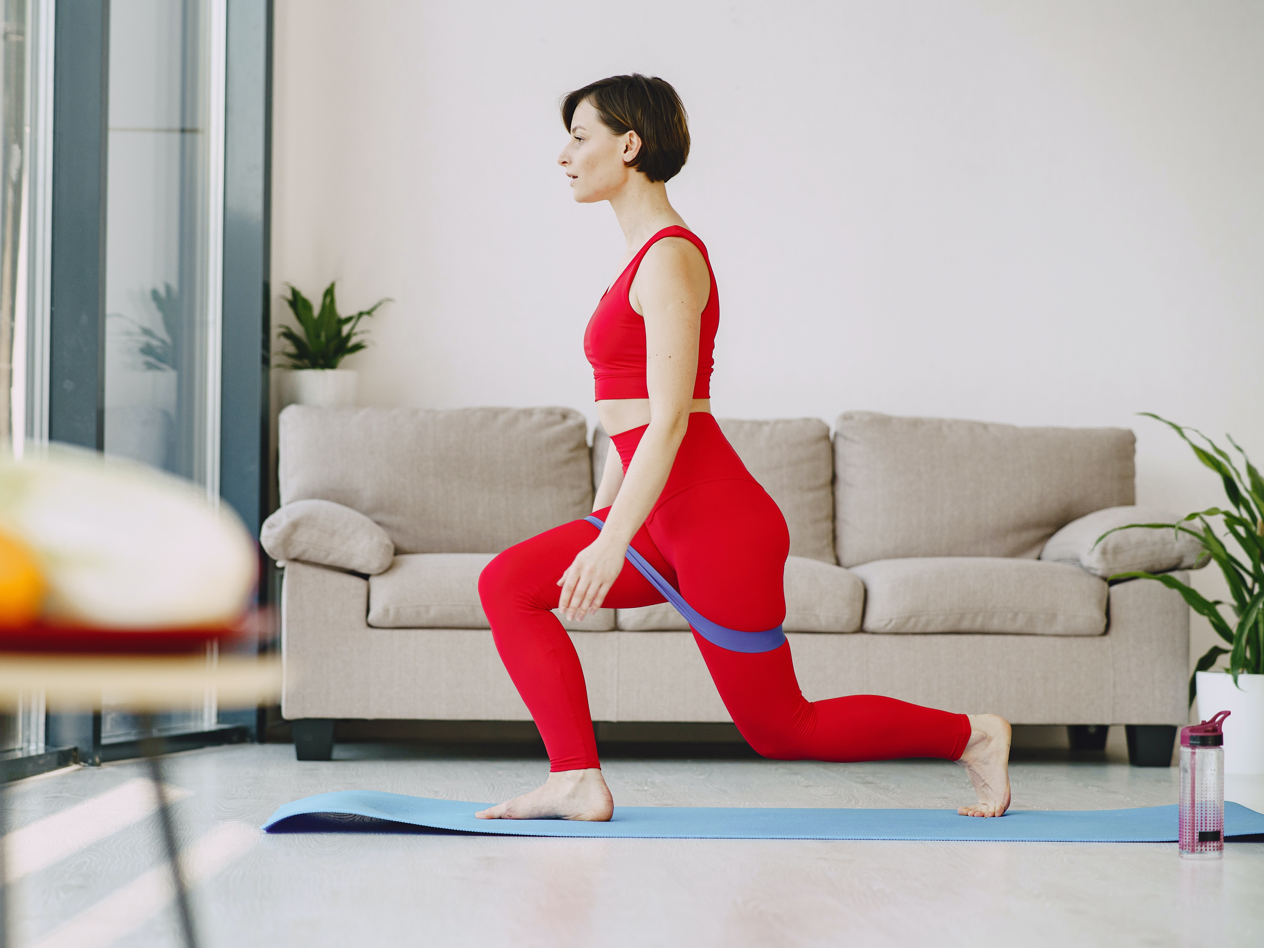 sportswoman-doing-stretching-exercise-on-mat-4148919