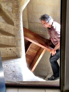 """Hauling furniture up the winding steps to the """"tower"""""""