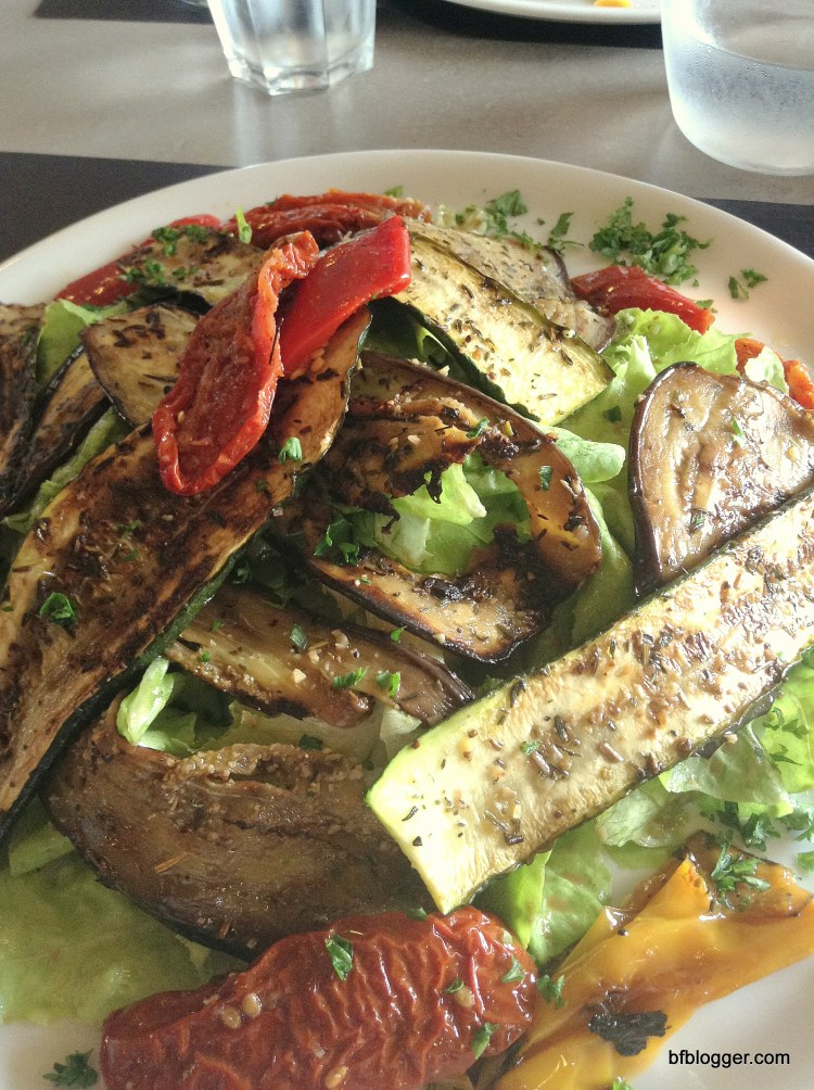 Roasted aubergine and peppers on fresh greens