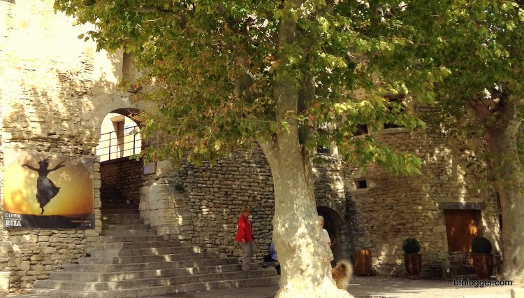 Public gathering places with ancient shade trees and stone arches