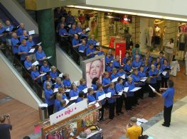 Singing on the escalators in a Tallinn shopping centre.