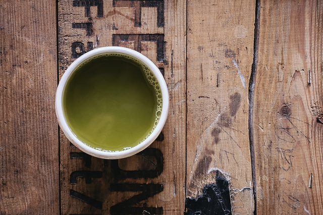 green tea on wooden background