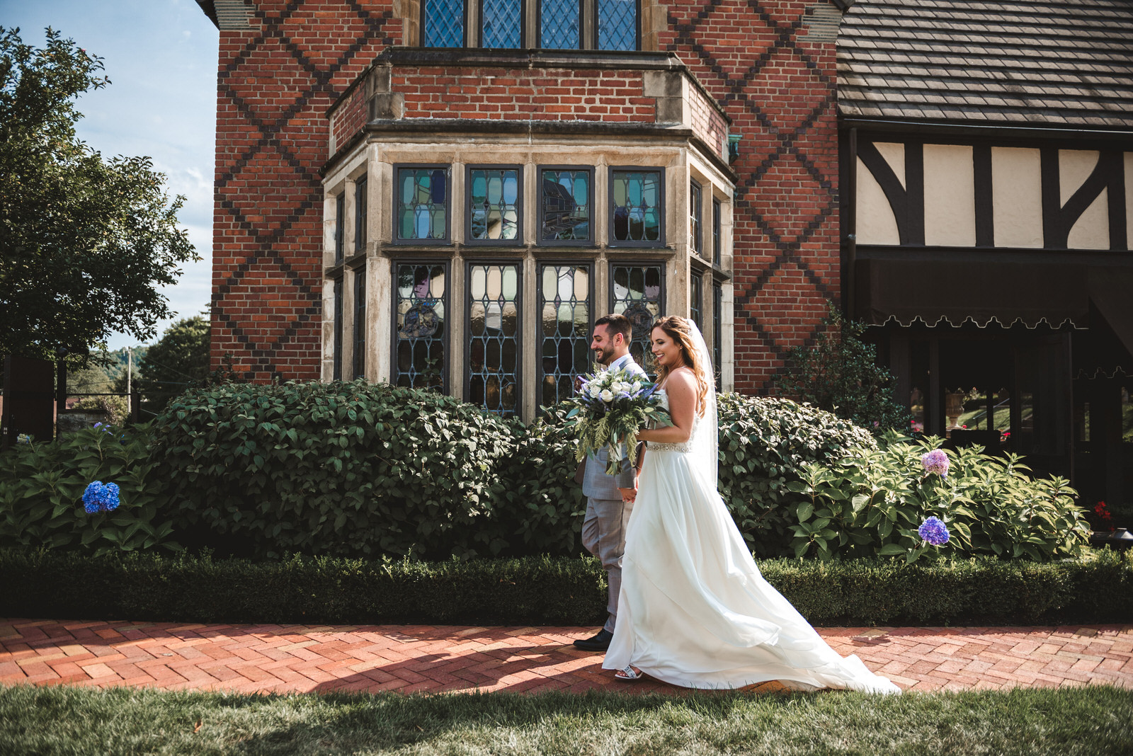bride and groom walking around Zenner House in Athens Ohio
