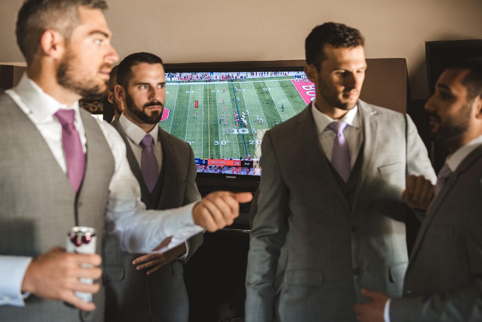 football game on at wedding