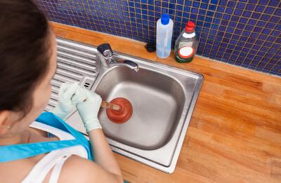 get rid of black gunk in sink drains
