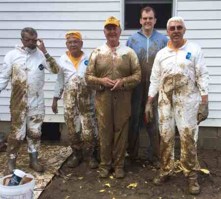 George (right) and his team accomplished some dirty work in West Virginia after the 2016 floods.