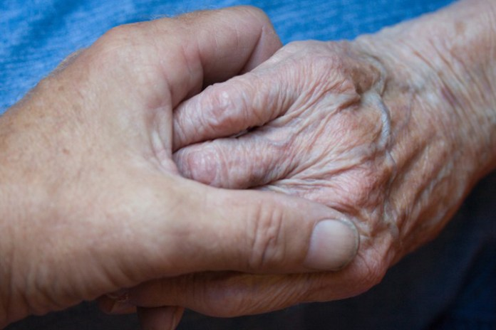 holding elderly person's hand - Billy Graham Daily Devotion 17 May 2018 - Faith Produces Works