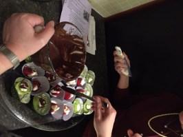 Strawberries and Kiwi, adding melted dark chocolate