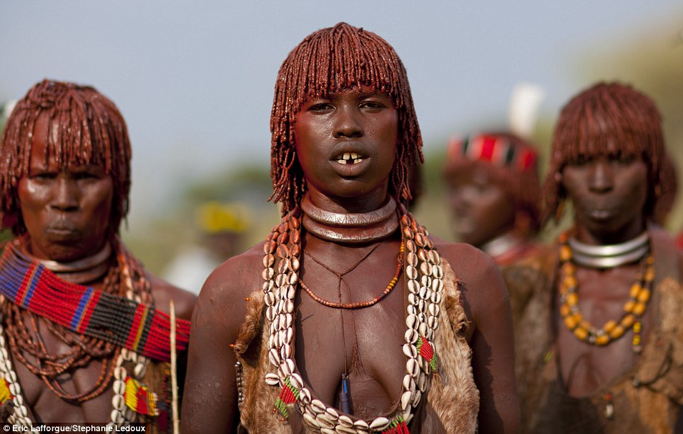 14 Photos Of Ethiopian Tribespeople Who Use Butter To