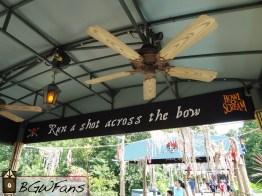 Run a shot across the bow