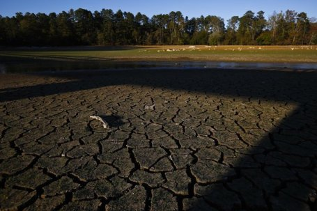 Lake Purdy which has receded several feet due to drought, leaves dry, cracked ground where lake water should use to be, Tuesday, Oct. 11, 2016, in Birmingham, Ala. Hotter than normal temperatures combined with the below normal rainfall have worsened drought conditions across Alabama. (AP Photo/Brynn Anderson)