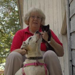 Image may include: Kathy, her cat, and dog, cat trapping