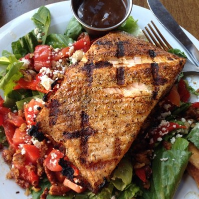 Image may include: mediterranean salad with salmon