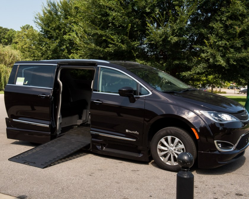 Photo of a black, wheelchair accessible van.